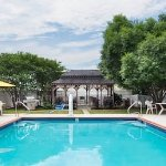Pool Area with grill and gazeebo