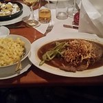 some kind of roast (schweinebraten - pork roast, probably) with fried oninons on top and spätzle