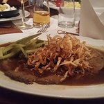 roast with fried onions and accompanied by spätzle