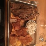 Brisket with chips and potato salad