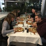 Pizza Family in Italia with each having his favorite Pizza