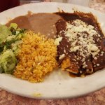 Cheese filled enchiladas, beans, and rice for an authentic Mexican dinner