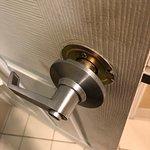 Broken door handle on bathroom door.