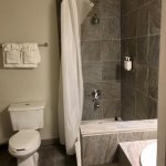 Clean bathroom with shampoo, body wash, body lotion...