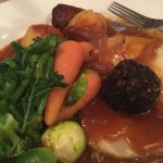 Baked celeriac with vegetables, soup, curry & olives