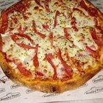 صورة فوتوغرافية لـ Happy's Pizza