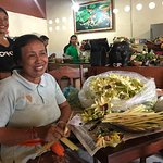 The friendly owner (I believe) and staff preparing their palm offerings