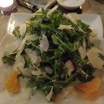 Arugula salad with mandarin and Parmesan cheese