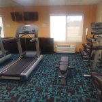 Fitness Room with Free Weights, Bench, Treadmill & Elliptical