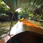 teak boat along the canal, sunny day