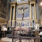 Picture of Pope, with statue of Jesus on the Cross behind him