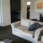 There is also a small sitting area, perfect for putting any extra luggage you may have