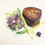Filet Mignon, mashed potatoes scented with red wine, grilled white asparagus and pea shoots
