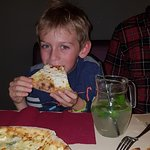 Youngest of our group digging in to his pizza.