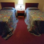 Wrong size bedspreads causing potential tripping problem for guests