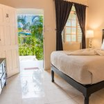 Standard room with 1 double bed, walk-in rainfall shower and cable television