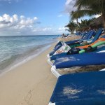 Beach Front area, beautiful clear water and clean sand with many chairs to choose from
