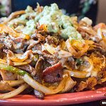 Try our delicious Nachos Machos. Cook with steak, beacon, grilled onions, and bell peppers.