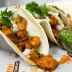 Street tacos fill with your choose of meat and top off with cilantro and onions.