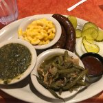Sausage with three house mates, or sides, including Jalapeno Creamed Spinach
