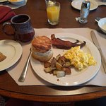 Coffee & juice, blueberry scone, fruit, thick cut bacon, potatoes, and tallest biscuit I ever sa