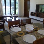 Dining area inclusive of dinnerware and glassware for 6 people.