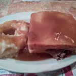 Roast beef sandwich and side of mashed potatoes with gravy