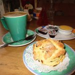 Delicious hot scones with jam and clotted cream