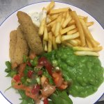 Fish goujons with chips and mushy peas