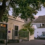 The entrance to Aubergine with Table Mountain as backdrop