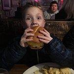 Our 8yo taking on a 3/4 cheeseburger.