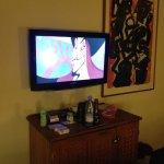 TV with bar fridge below