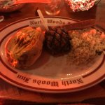 filet mignon with baked potato and rice pilaf