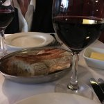 crusty bread, butter that makes you appreciate butter! A lovely glass of red to top it off.