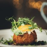 Smoked haddock fish cake with a poached hens egg