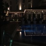 Front of this grand hotel and view of the pool at night!