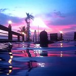 From in the pool, on a purple sunset.
