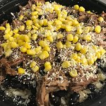 We have numerous choices for our rice bowls....this one is topped with Beef Barbacoa and Corn.