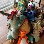 a collection of stuffed dragons in the great room