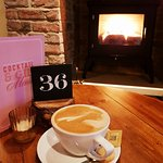 Who wouldn't like a coffee by the fire?