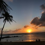 Sunset and palm trees at Poipu Beach