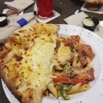 Creole Pasta and a Pepperoni with Sausage Pizza