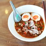 vermicelli in spicy soup with pork and soft boiled egg