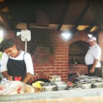 The Pool Grill has the best wood fired pizzas (and the best cooks!)
