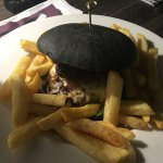 The burger has two patties and comes with a bun infused with squid ink to make it black