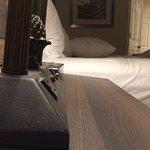 Tilted bedside table. Don't let your stuff slide off!