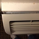 Top view of heating/A/C unit falling off the wall.