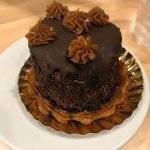 This pretty tiny cake is a delicious mound of chocolate and dulce de leche.