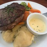 Sirloin steak with yummy kumara and potato mash and garlic sauce.