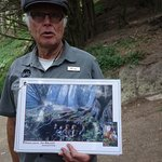 This is Ray with his book of photos of Lord of the Rings scenes standing in front of the same sc